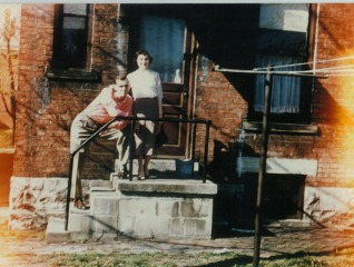 old picture mom and dad outside apt