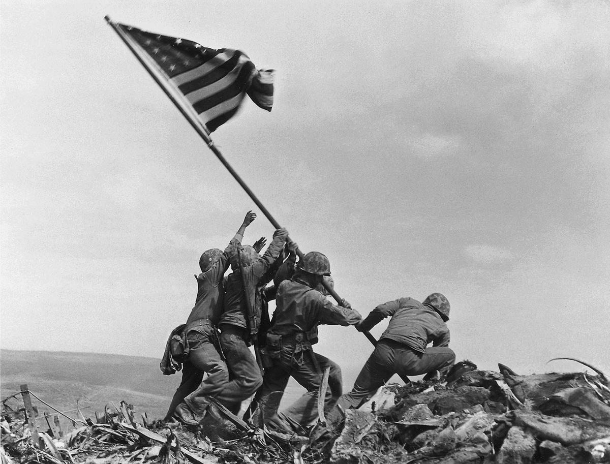 us marines 28th regiment of fifth division raise flag atop mt suribachi iwo jima costliest in marine corps history 7k soldiers killed 36 days fighting