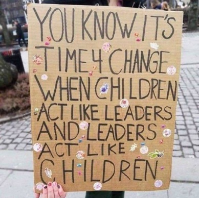 Sign about Greta and the children acting more like leaders than adults Climate change Global warming