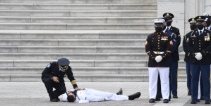US Sailor collapses in heat during honor guard service Rep John Lewis funeral ceremony